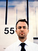 Businessman in Front of 55 Sign