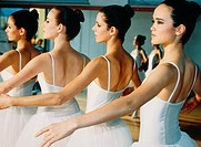 Four female teenagers in a ballett room