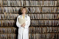 Doctor Stands in Front of Patient Files