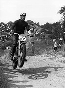 sport, motocross, man driving on motorcycle, jump, onlookers, late 1970s,