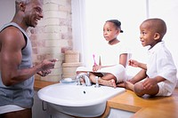 Father with Son and Daughter in Bathroom