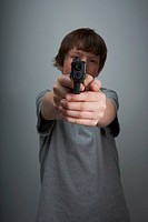 Young boy with handgun.