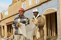 Construction Workers at New Housing Development Reviewing Plans, Ajax, Ontario