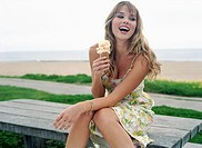 Smiling Woman with Ice Cream Cone