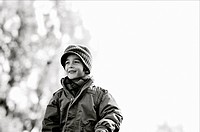 Happy boy outside with scarf and wool hat, Otterburn Park, Quebec