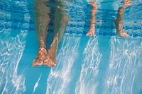 Mother and Daughter's Feet in Swimming Pool