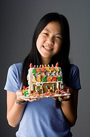 Girl Holding Gingerbread House
