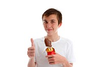 boy with easter chocolate thumbs up