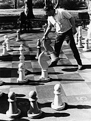 games, chess, men playing chess in park, circa 1960s,