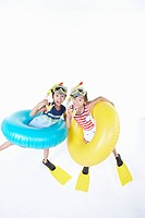 girl and boy are wearing snorkels and tube and flippers
