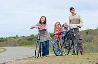 A family with children on their bikes