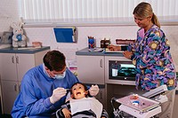 Dental Team Doing Procedure on Boy