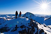 Two climbers enjoy the view from the summit of a mountain, Pe&#241;a Cerreos, Parque Natural Ubi&#241;as-La Mesa, Asturias, Spain