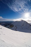 A strong sun focuses on the snowy mountains, Pe&#241;a Ubi&#241;a massif, Parque Natural Ubi&#241;as-La Mesa, Asturias, Spain