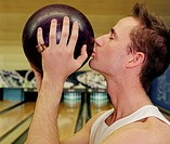 Man Wearing Kissing His Bowling Ball for Luck