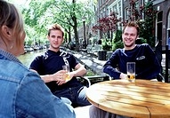 Friends Drinking Beer at Outside Table