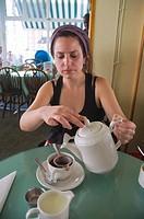 Tea drinking Muffinman tea room Kensington district London England UK Europe