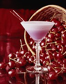 Glass of cocktail with cherries, close_up