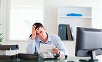 Young businessman worried about invoice