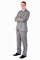 Serious looking businessman on white background