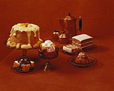 Various cakes on red background