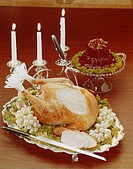 Roasted turkey with illuminated candles, close_up