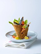 Crisp bread cup filled with sardines and salad