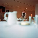 Waiter Setting Tables