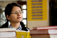 Girl in a school library