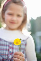 Close up of girl holding flower