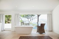 Upright bathtub in modern bathroom