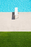 Diving board over pool