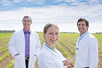 Scientists standing in field