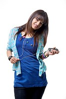 Young woman with MP3 player listening music over white background