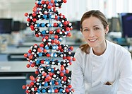 Scientist with molecular model in lab (thumbnail)