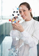 Scientist examining molecular model in laboratory