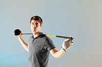 Golf player holding club