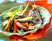 Grilled bass with young vegetables