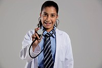 Portrait of a school girl with a stethoscope