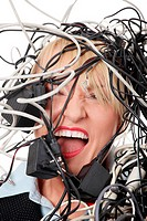 Mature businesswoman´s screaming in cables.