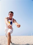 Man with Volleyball Pointing Excitedly