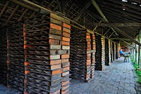 Drying yard with roof tiles in racks at brickworks, Boom, Belgium