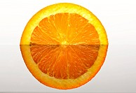 Orange slice reflected on glass