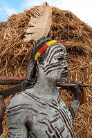 Karo warrior with bodypainting and rifle, Omo river valley, Southern Ethiopia