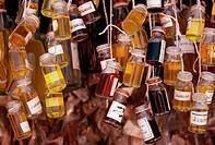 Small jars of perfume oil hang at the Ver_o_peso market, Para, Belem, Brazil.