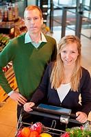 Happy Couple Buying Groceries