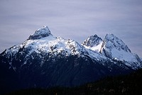 The snow capped peaks of one of the Coast Mountains. British Columbia, Canada.