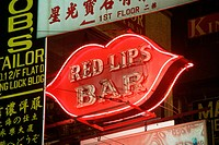 Neon lips advertise the Red Lips Bar, a famous Kowloon night spot.