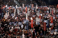 The delegates at the 1996 Republican National Convention in San Diego, California, hold signs for their home states and their candidates, Bob Dole and...