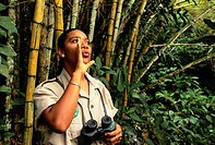 D. Etienne, a guide at Asa Wright Nature Centre in Trinidad, makes bird calls on a forest trail.